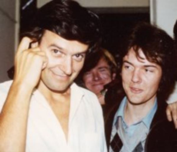 Backstage, talking to John McLaughlin in 1979.